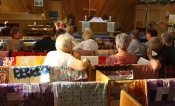With our KOG members settling in on the quilt-coverred pews, service is about to begin.
